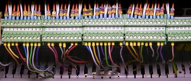 Terminal blocks for electrical connection and earthing terminals for grounding in the control cubicle. Wires with. Caption fields Stock Image