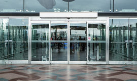 Terminal building gate entrance and automatic glass door. Airport terminal building gate entrance and automatic glass door stock photography
