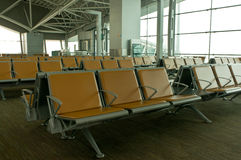 Terminal building. Rows of seating in an empty airport waiting area Royalty Free Stock Photo