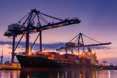 Terminal container loading at twilight, cargo and shipping, logi. Stics yard Stock Images