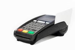 Terminal with credit card. On a white background Royalty Free Stock Photography