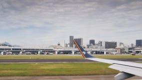 Terminal d'aéroport du ` s Santos Dumont de Rio de Janeiro et horizon du centre Images libres de droits