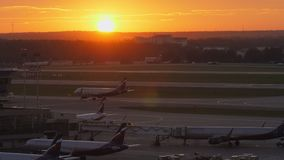 Terminal D with planes at Sheremetyevo Airport in Moscow, Russia. View at sunset. MOSCOW, RUSSIA - AUGUST 07, 2017: Sheremetyevo Airport at golden sunset. Parked stock video