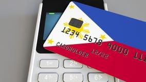 Terminal de paiement avec la carte de crédit comportant le drapeau des Philippines Rendu 3D conceptuel national de système bancai illustration libre de droits