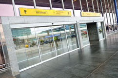 Terminal 1 entry of Vaclav Havel Airport Prague. Prague international airport of the Czech Republic. Opened glass door from the principal entry inside airport Stock Photography