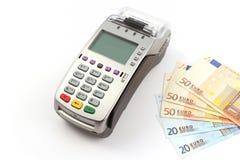 Terminal et argent de banque Images libres de droits