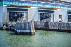 Terminal ferry docks ready for an arrival of the Staten Island Ferry in Battery Park Manhattan NYC. On a sunny day stock photo