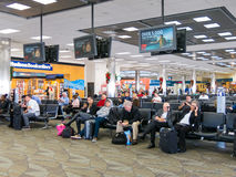 Terminal of Fort Lauderdale airport, Florida, USA. People sitting and waiting on Fort Lauderdale Hollywood International Airport in Florida, USA Stock Image