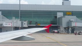 Terminal Four in Changi Airport. Changi, Singapore - November 22, 2018 : Terminal 4 in Changi Airport view from taxiing airplane AirAsia, airplanes parked near stock video