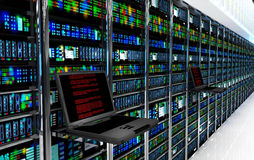Terminal monitor in server room with server racks in datacenter interior Royalty Free Stock Image