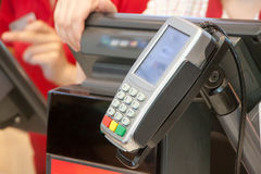 The terminal for payment by cash cards. On cash desk in cafe Stock Photography