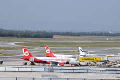 Terminal spotting at Vienna Airport with Air Berlin Airbus a320 and Finnair Embraer erj190 in the beautiful shot Royalty Free Stock Photos