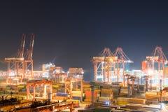 Terminale di container alla notte Immagine Stock Libera da Diritti