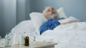 Terminally ill male sleeping in hospital after taking painkillers, medication. Stock footage Royalty Free Stock Images