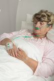Terminally ill senior woman stock images