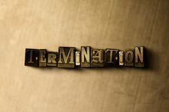 TERMINATION - close-up of grungy vintage typeset word on metal backdrop Royalty Free Stock Image