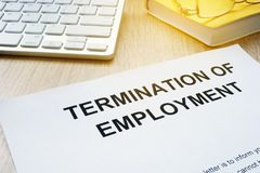 Termination of Employment on a desk. Termination of Employment on an office desk stock images