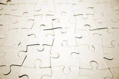 Terminez le puzzle denteux blanc Photographie stock libre de droits