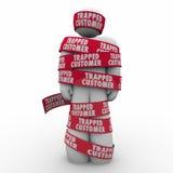 Termini bloccati di Person Wrapped Tape Bound Contract del cliente Fotografie Stock