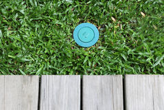 Termite bait system in the blue lid. Stoping termite damage the house Stock Photo