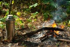 Termo cerca del fuego foto de archivo libre de regalías