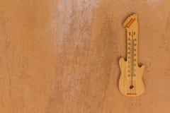 Termometer formad gitarr Fotografering för Bildbyråer
