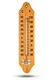 Termometer på trägrund med den celsiusa skalan Symbol för din des Royaltyfri Foto