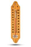 Termometer på trägrund med den celsiusa skalan Symbol för din des Arkivfoton