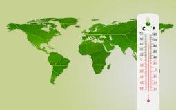 Termometerkontroll världskartatemperaturen med inverkan av globalt royaltyfria foton