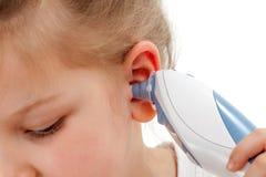Termometro di orecchio Immagini Stock