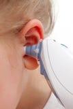Termometro di orecchio Fotografie Stock