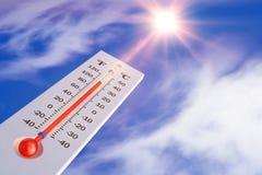 Termometro e sole Immagine Stock