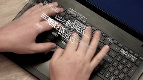 Terms about business and finance fly away from hands on keyboard. Caucasian man hands rapidly typing on laptop keyboard. Terms about business and finance fly stock footage