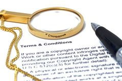 Terms and Conditions. With magnifier and pen Stock Photography