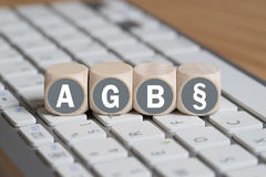 Terms and Conditions (as acronym AGB in German). On cubes on a keyboard Stock Images