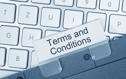Terms and conditions. On folder tab with computer keyboard Stock Photo