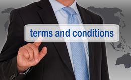Terms and Conditions - Manager with touchscreen. On world map background royalty free stock photography
