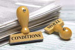 Terms and conditions. Marked on rubber stamp Stock Images