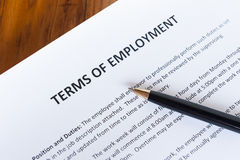 Terms of Employment. Contract outlining the terms of employment with a pen Stock Image