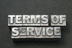 Terms of service bm. Terms of service phrase made from metallic letterpress blocks on black perforated surface Royalty Free Stock Image
