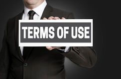 Terms of Use sign is held by businessman Stock Images