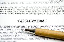 Terms of use with wooden pen stock photography