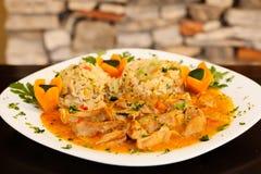 Ternera y arroz en la placa Fotografía de archivo libre de regalías