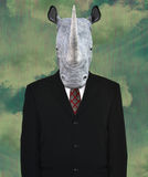 Terno de negócio surreal, rinoceronte dos animais selvagens Imagem de Stock