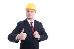 Terno do coordenador ou do arquiteto, laço e capacete de segurança vestindo Foto de Stock Royalty Free