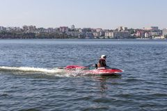 Pilot motorboat car. Ternopil, Ukraine - 25-26 August 2018: UIM World Championship 2018 Ternopil Hydro GP. Water motor sport. Formula-1 on the water. Race on the royalty free stock image