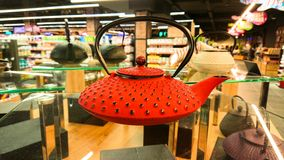 Ternopil, Ukraine - February 03, 2019: Red metal cast-iron kettle in shop stock photos
