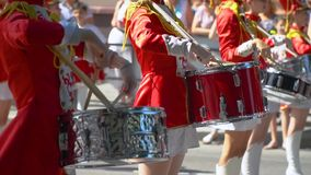 Ternopil, Ukraine June 27, 2019: Street performance on the occasion of the holiday. Close-up of female hands drummers. Ternopil, Ukraine June 27, 2019: Close-up stock footage