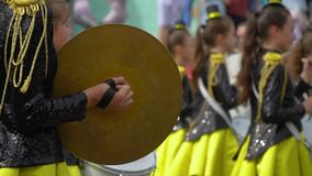 Ternopil, Ukraine June 27, 2019: Young girls drummer at the parade. Ternopil, Ukraine June 27, 2019: Close-up of female hands drummers are knocking in the drum stock video