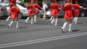 Ternopil, Ukraine June 27, 2019: Young girls drummer in red at the parade. Street performance on the occasion of the. Holiday. Young drummers line up and beat stock video footage